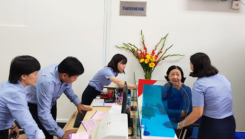 Customers come to trade at BIDV Tri Ton Transaction Office